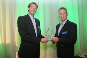 Swallow Solutions CEO Eric Horler and EVP Ray Heller pose with the First Place Innovation Award from LINK LTC.